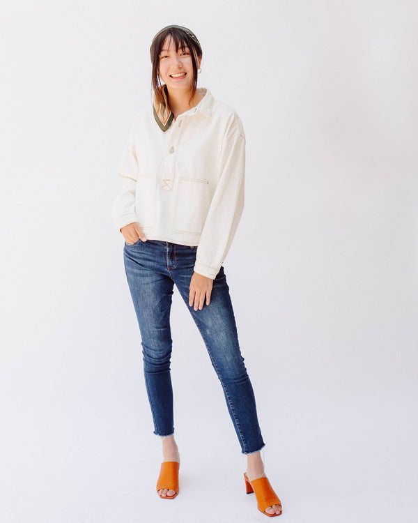 white denim button up collared pullover jacket