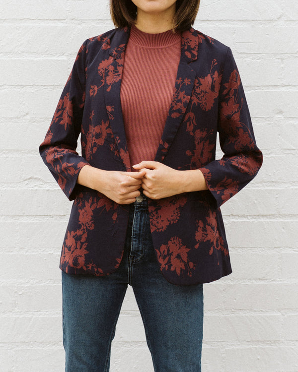 detail of navy blue and rust red floral print blazer