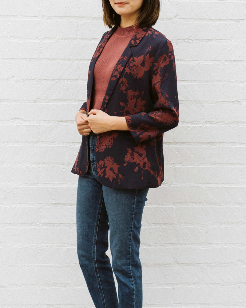 side detail of navy blue and rust red floral print blazer