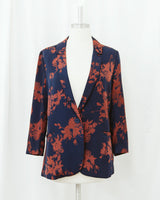 mannequin wearing navy blue and rust red floral print blazer