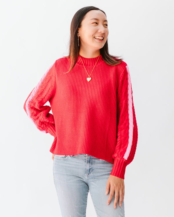 red cable knit sweater with balloon sleeves and pink stripe