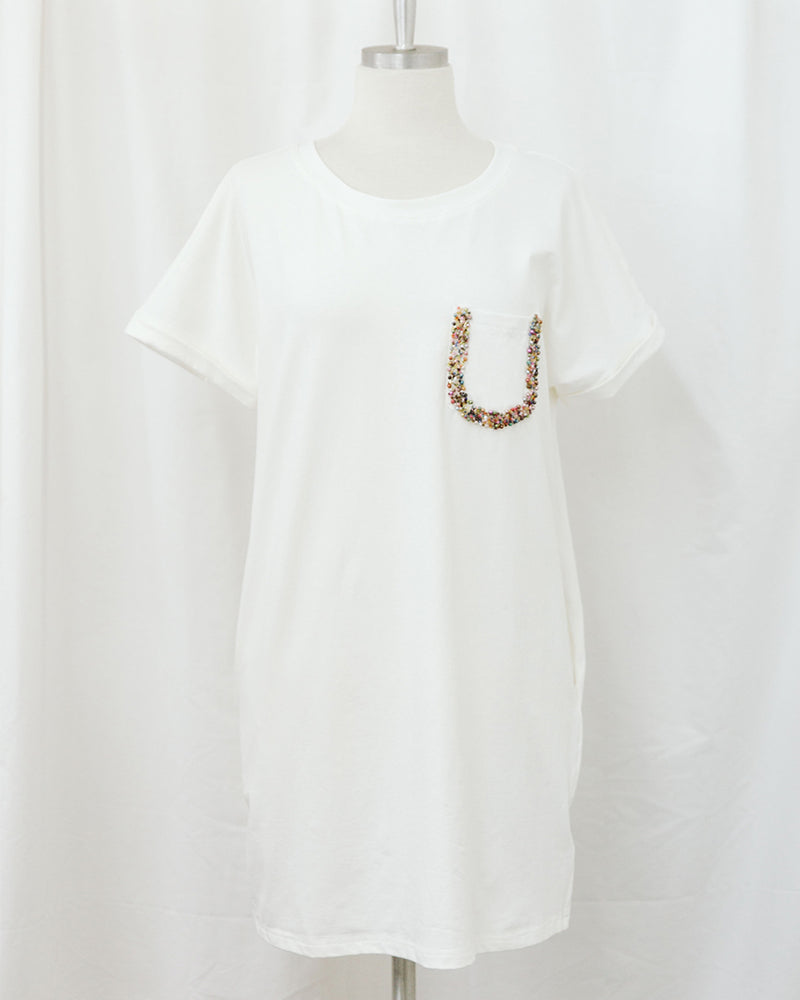 mannequin wearing white t-shirt dress with beaded pocket