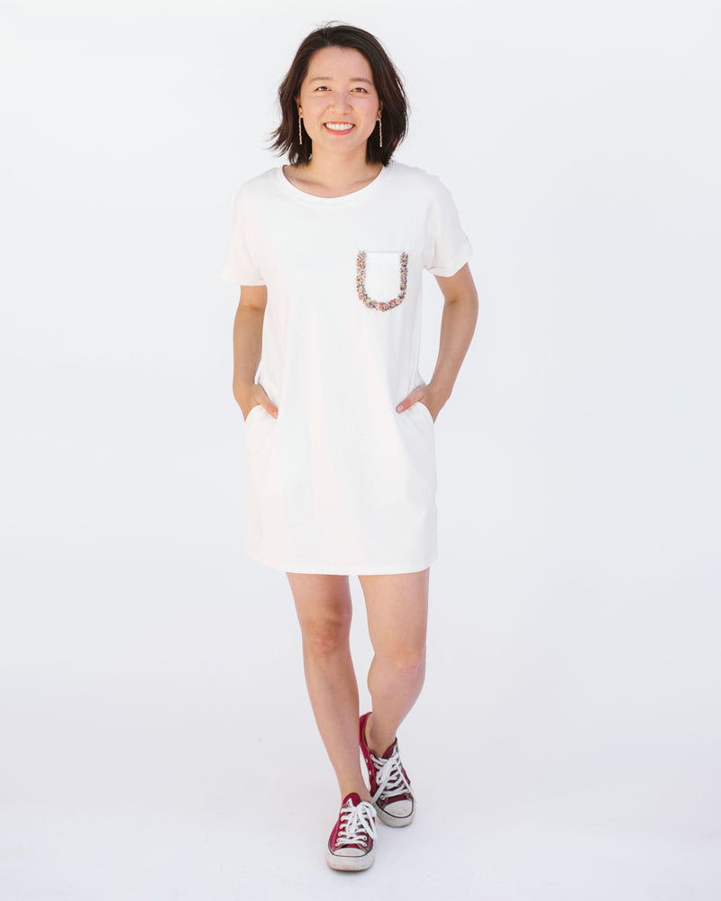 white t-shirt dress with beaded pocket