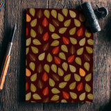 Seamless pattern with multicolored leaf on dark background Notebook | Artist : Designerchennai