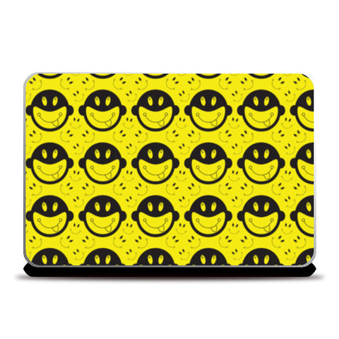 Monkey tongue out on black and yellow Laptop Skins | Artist : Designerchennai