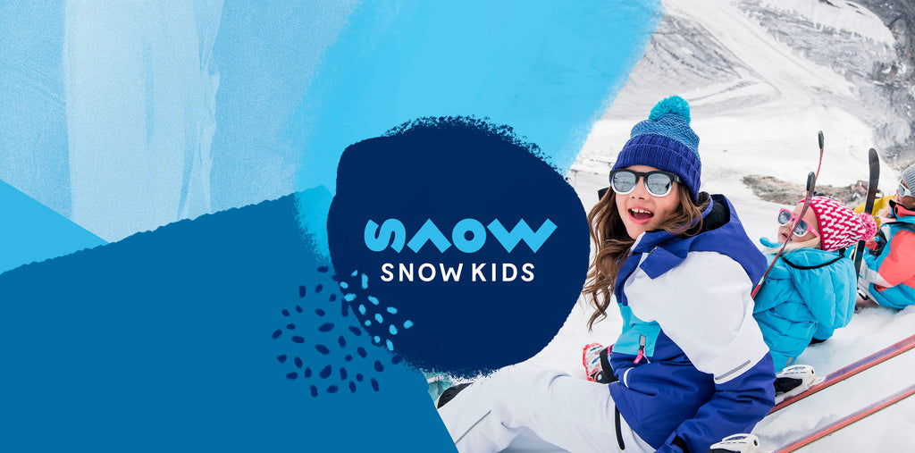 snowkids main logo banner with kids in snow gear and skis smiling and looking happy