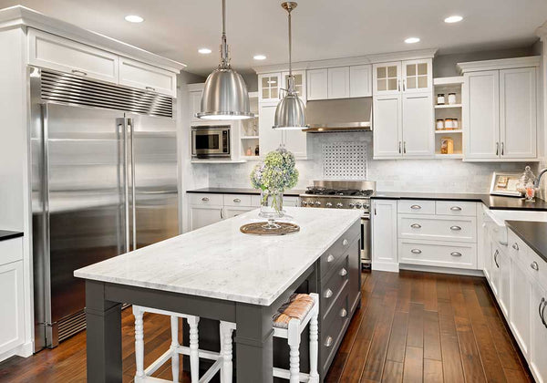 layered lighting example in kitchen with pendants downlights