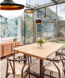 Replica tom dixon in Australian cafe with natural wooden furniture