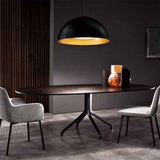 large dome shaped black pendant over dining table with grey fabric chairs ultra modern interior lighting 2020