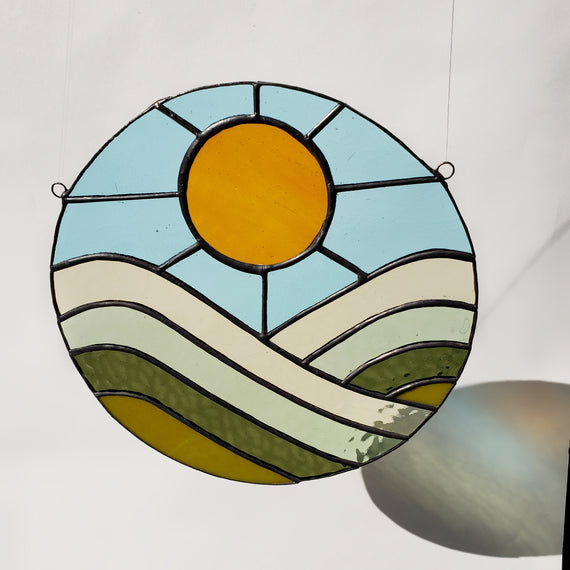 70's sunrise over rolling hills stained glass