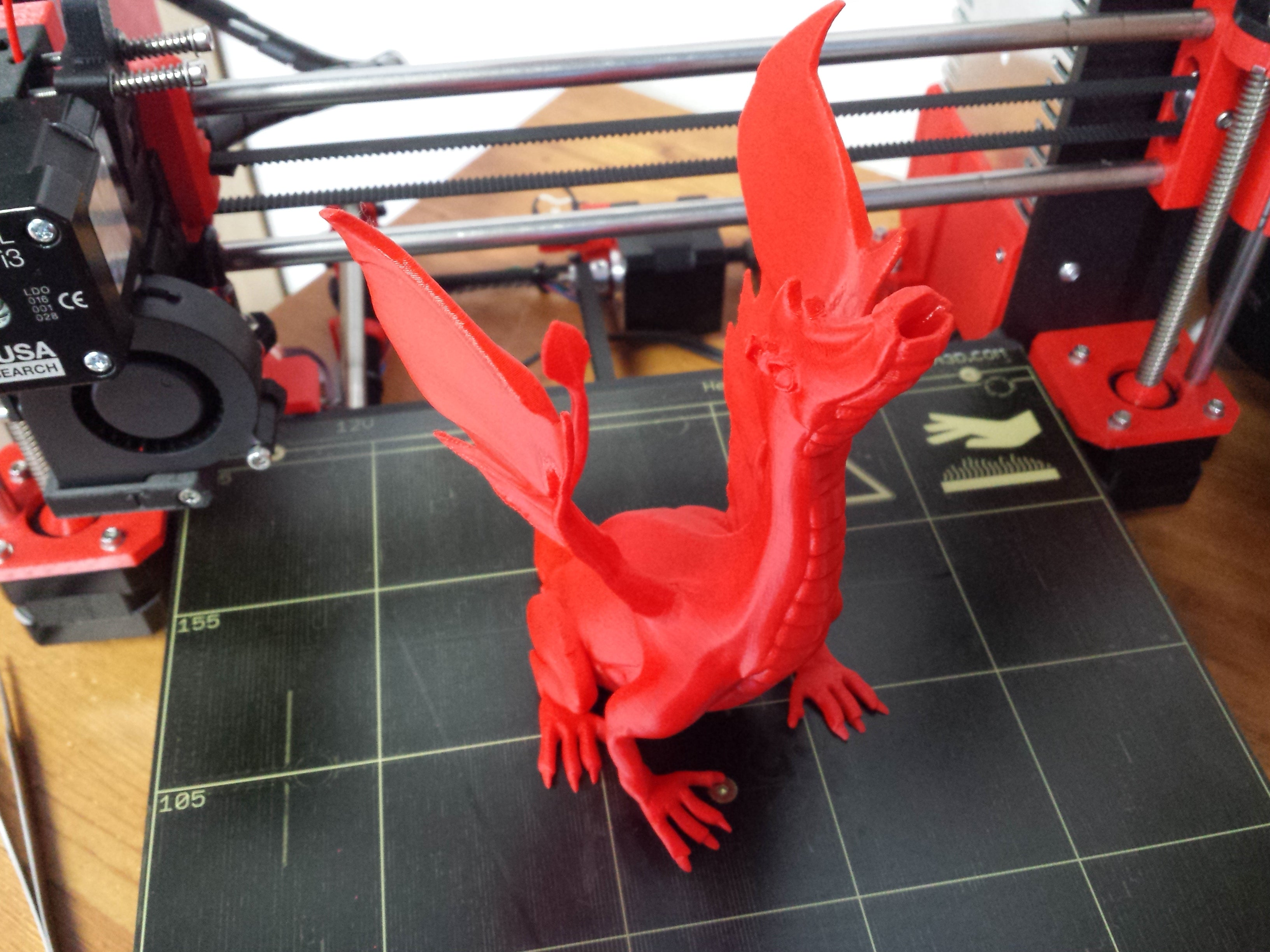 Picture of red dragon printed on Prusa i3 MK2 3D printer
