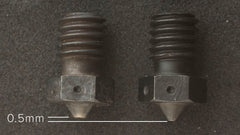 Hardened steel nozzle wear carbon fiber