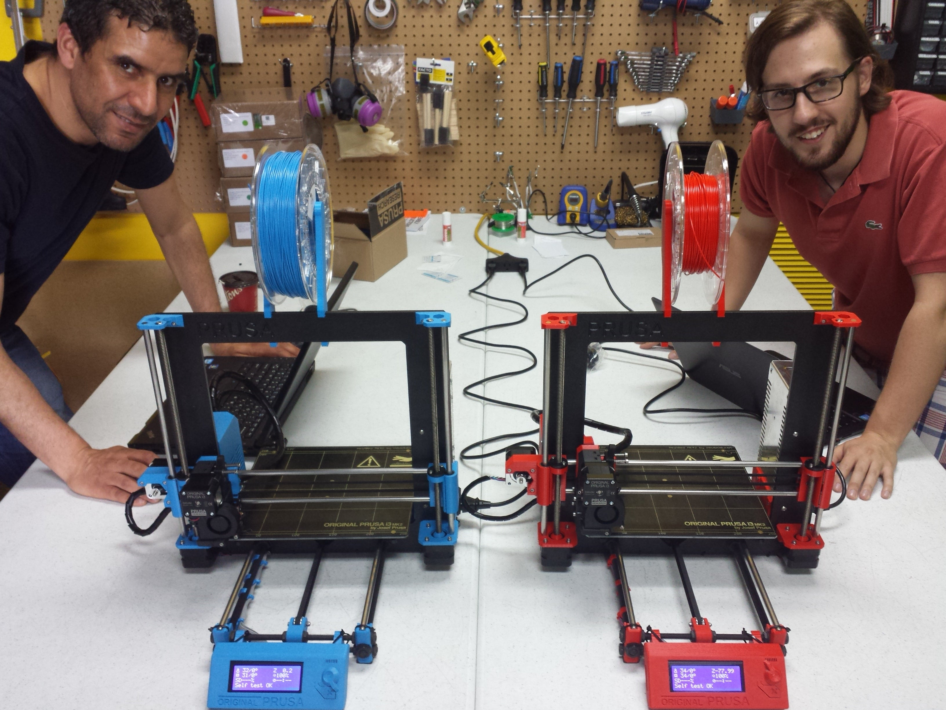Picture of two assembled Prusa i3 MK2 3D printers by Voxel Factory