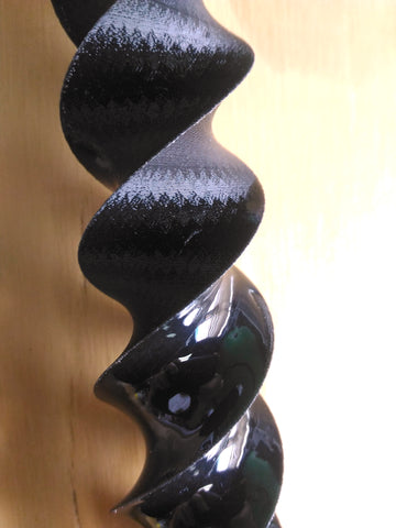Picture of Materio 3D Ivory Black PLA covered in XTC 3D epoxy coating at Voxel Factory