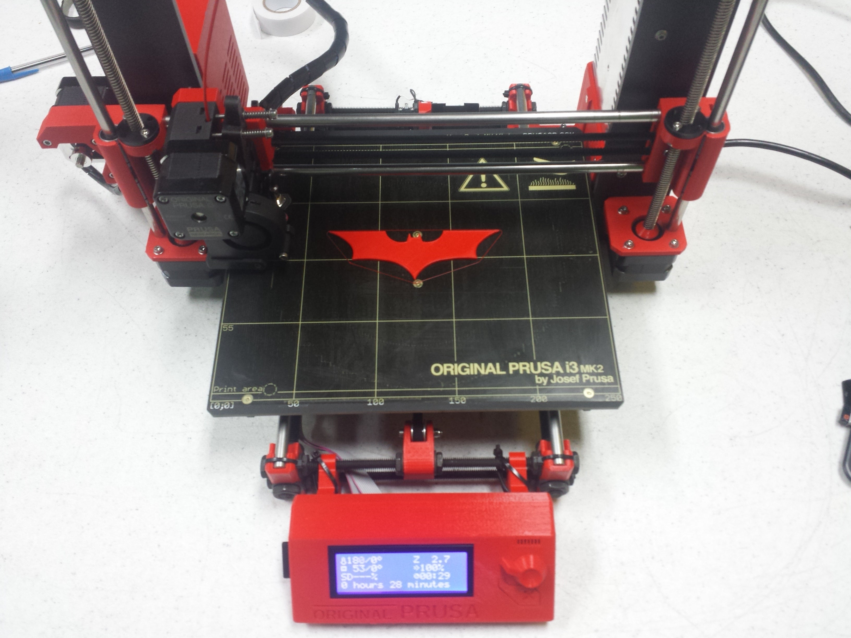 Picture of Original Prusa i3 MK2 red 3D printer printing Batman symbol