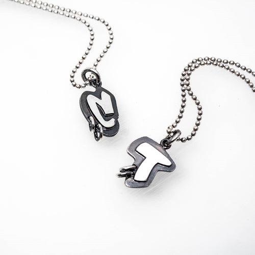 Example of Abstract Inititial Tag Sterling Silver Pendants in letters C and T. By TIN HAUS® Jewelry.