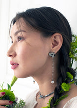 Load image into Gallery viewer, Equilibrium 14KT Gold Sterling Silver Earrings on model - TIN HAUS Jewelry