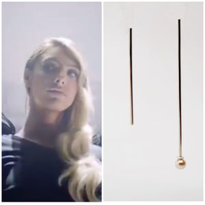 Lele Pons wearing the Cosmic Drop Pearl Earrings