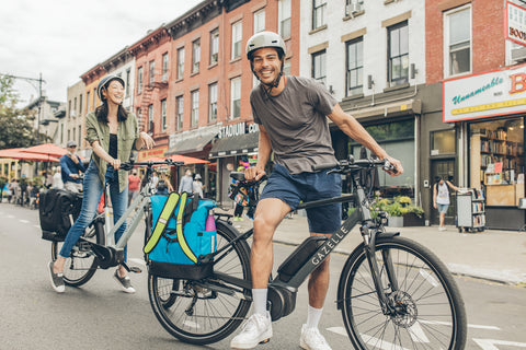 Two people on bikes with panniers - panniers for commuting