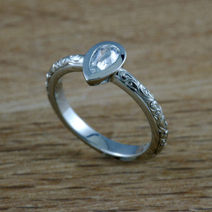 Pear shaped, hand engraved diamond engagement ring from  Era Design Vancouver.