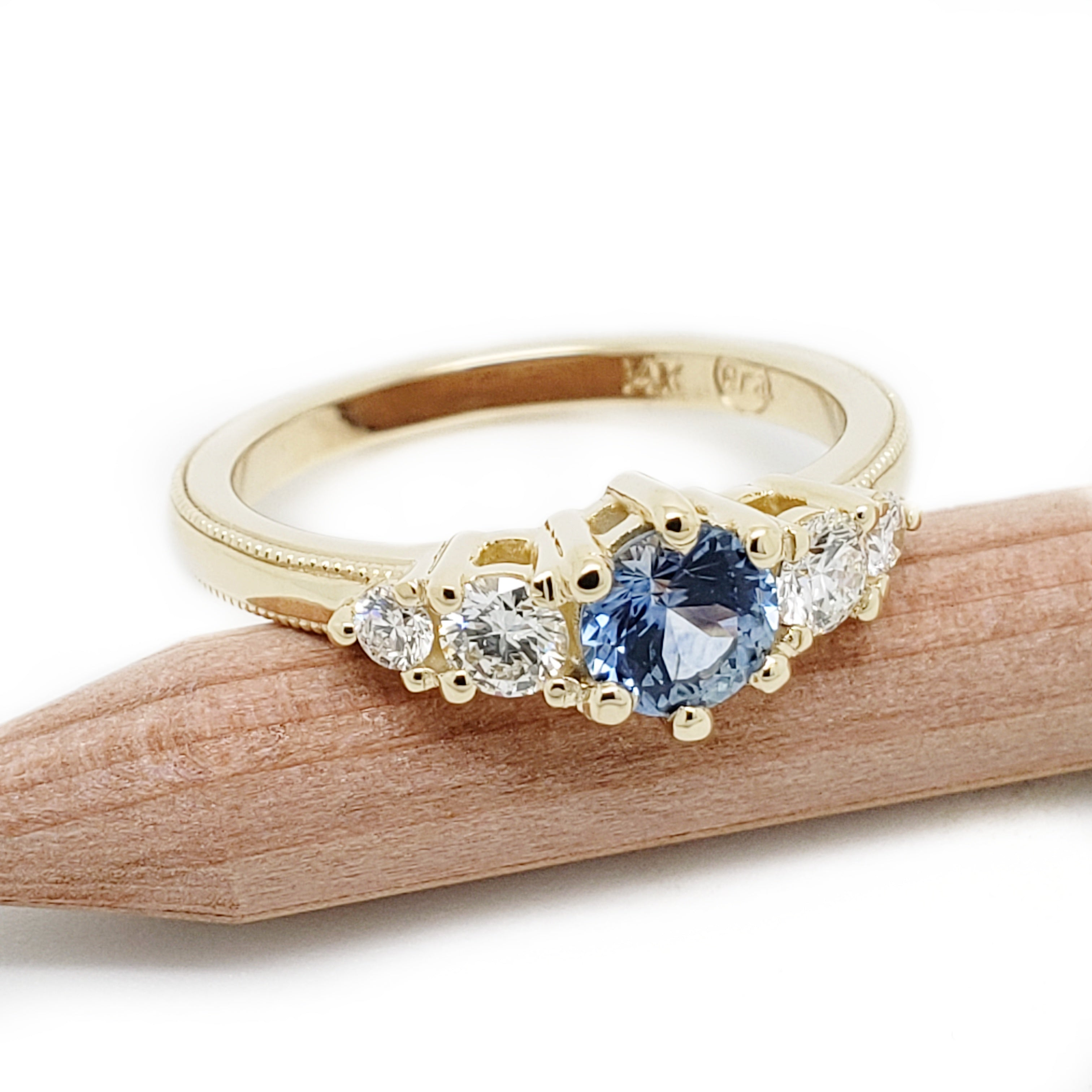 14kt yellow gold Montana sapphire Canadian diamonds five stone engagement ring millgrain era design vancouver