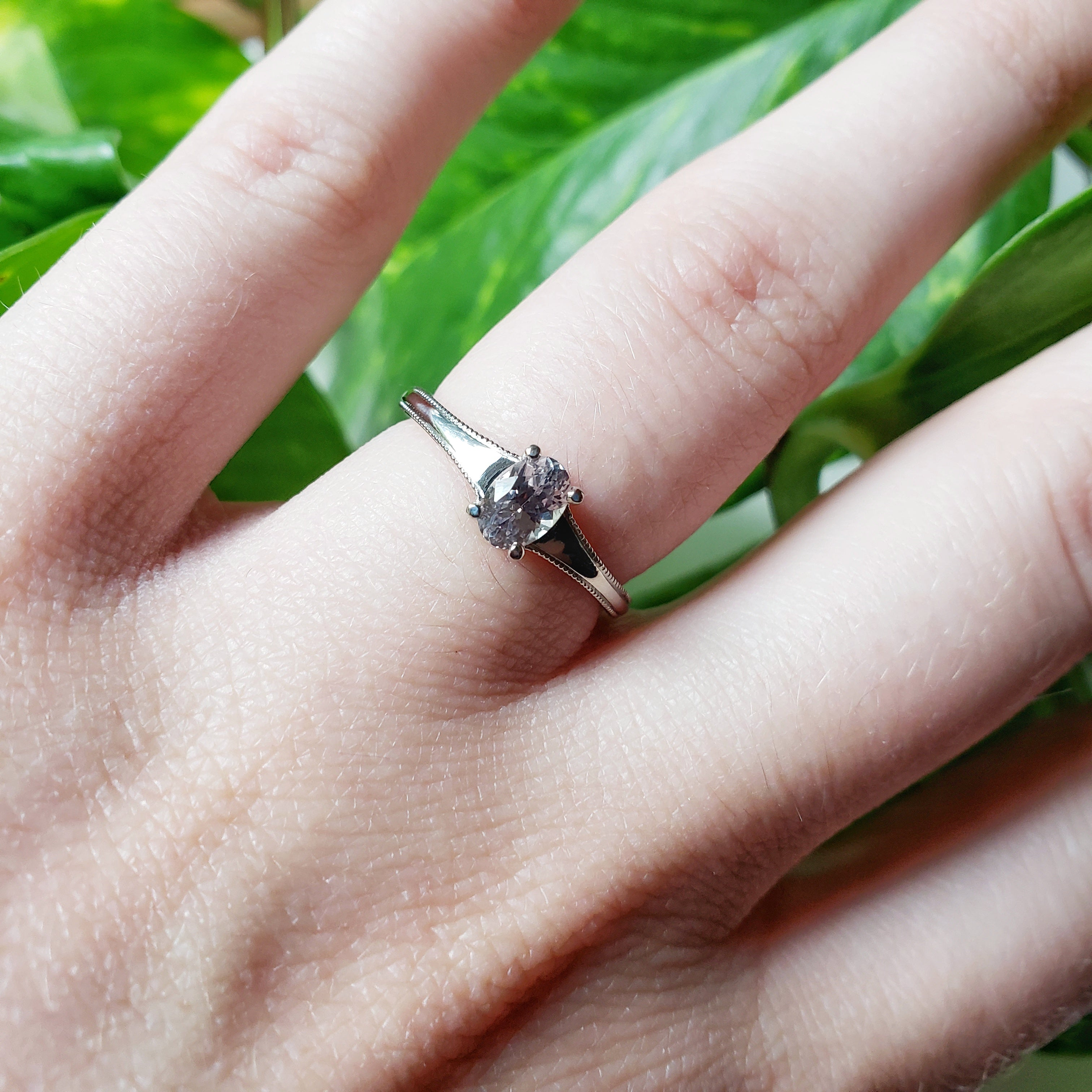 14kt white gold Brooke Montana Sapphire engagement solitaire ring grey smokey purple oval sapphire millgrain handcrafted era design vancouver