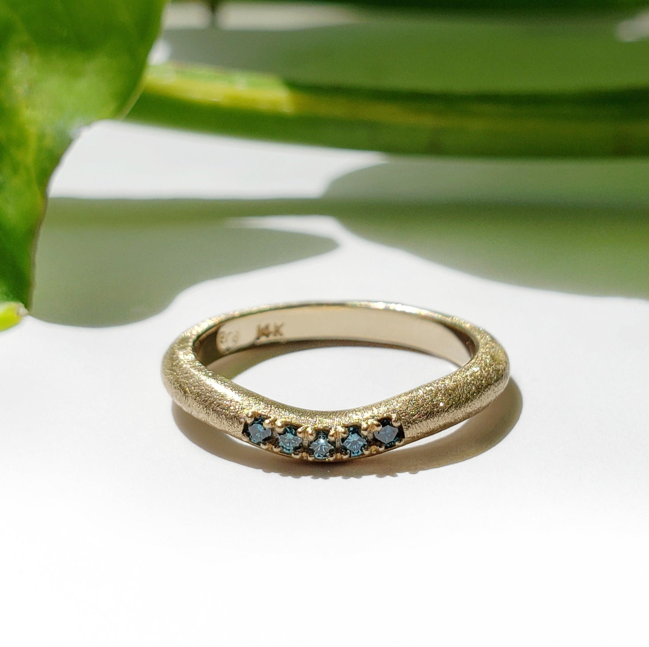 14kt yellow gold saw blade texture curved chevron wedding band blue treated diamonds era design