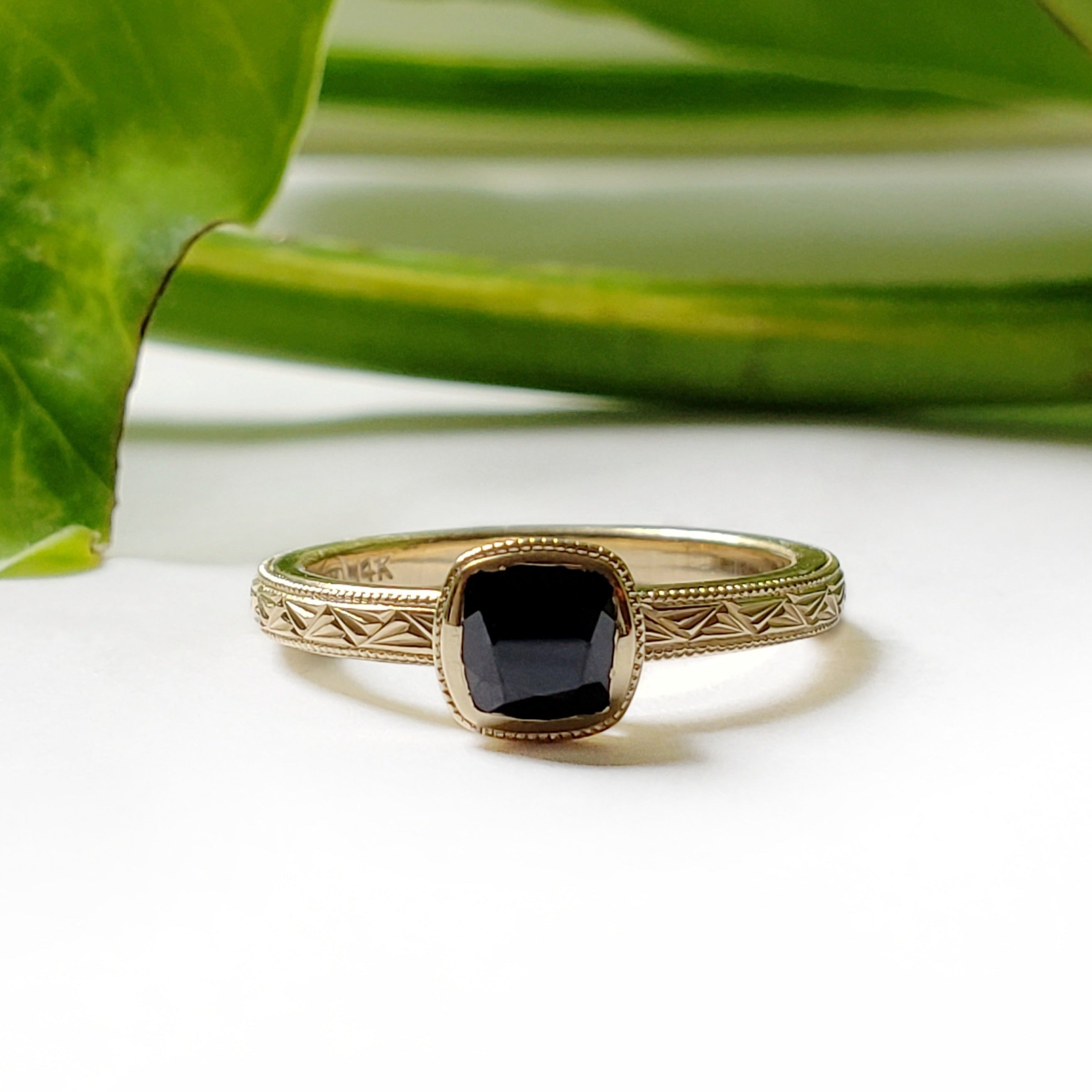 14kt yellow gold unique cushion cut black spinel bezel set engagement ring fan hand engraving era design