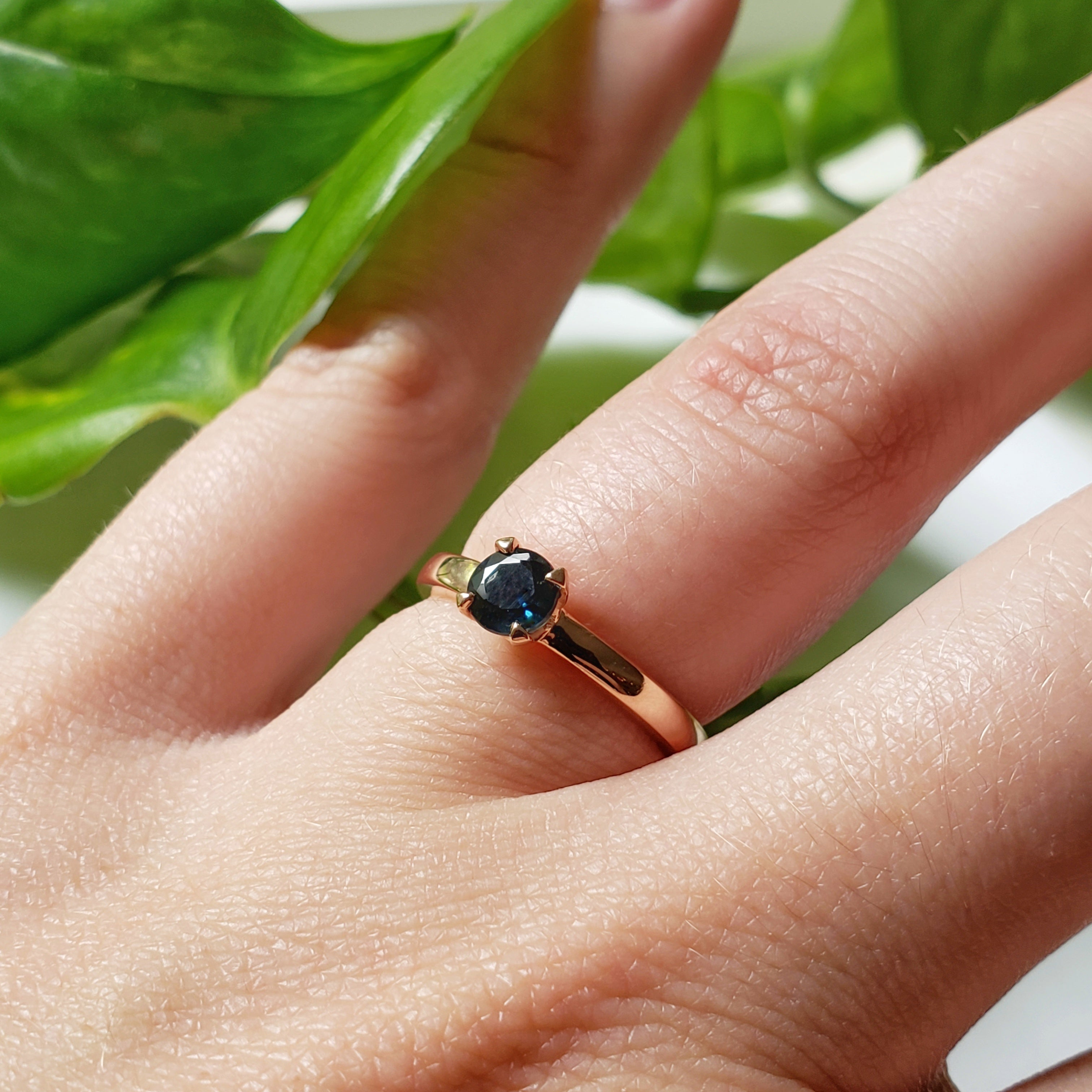 14kt rose gold unique solitaire engagement ring deep blue australian sapphire claw set era design