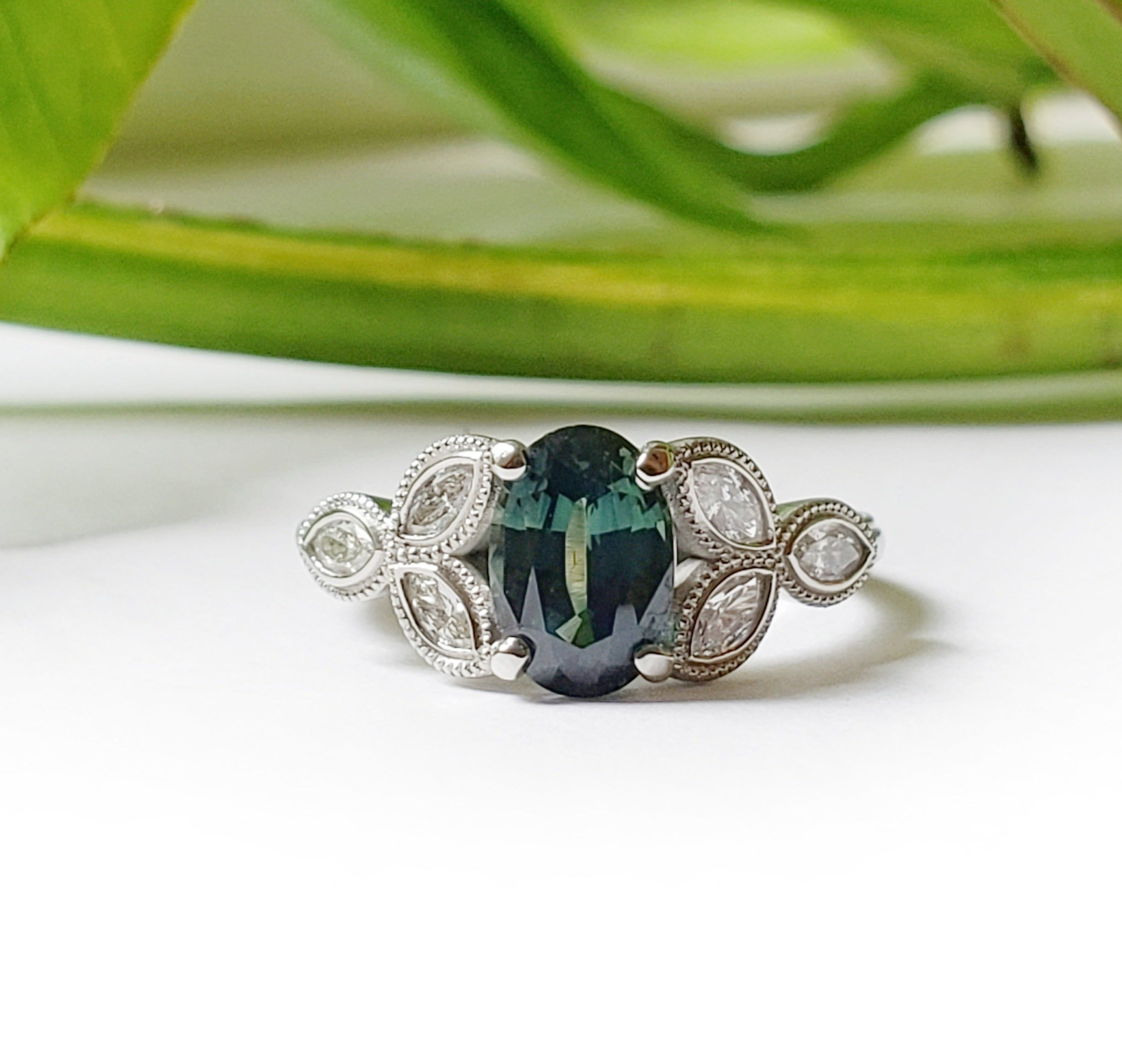 14kt white gold oval blue green Australian sapphire marquis diamonds millgrain vintage style leafy floral engagement ring era design vancouver
