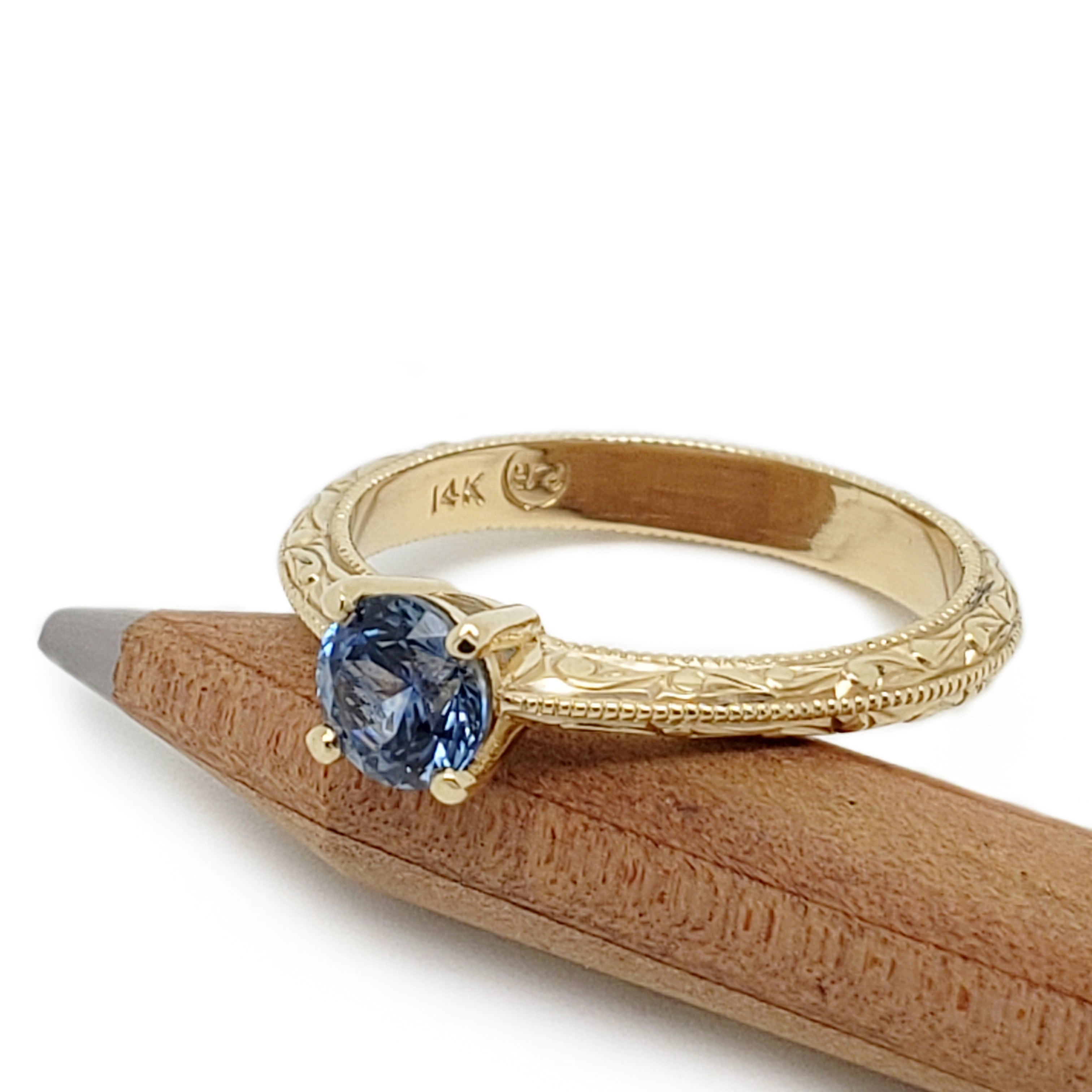 14kt yellow gold lavine solitaire blue montana sapphire engraved engagement ring era design