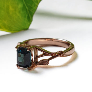 14kt rose gold Nigerian sapphire leafy terra engagement ring deep green gemstone custom floral era design vancouver