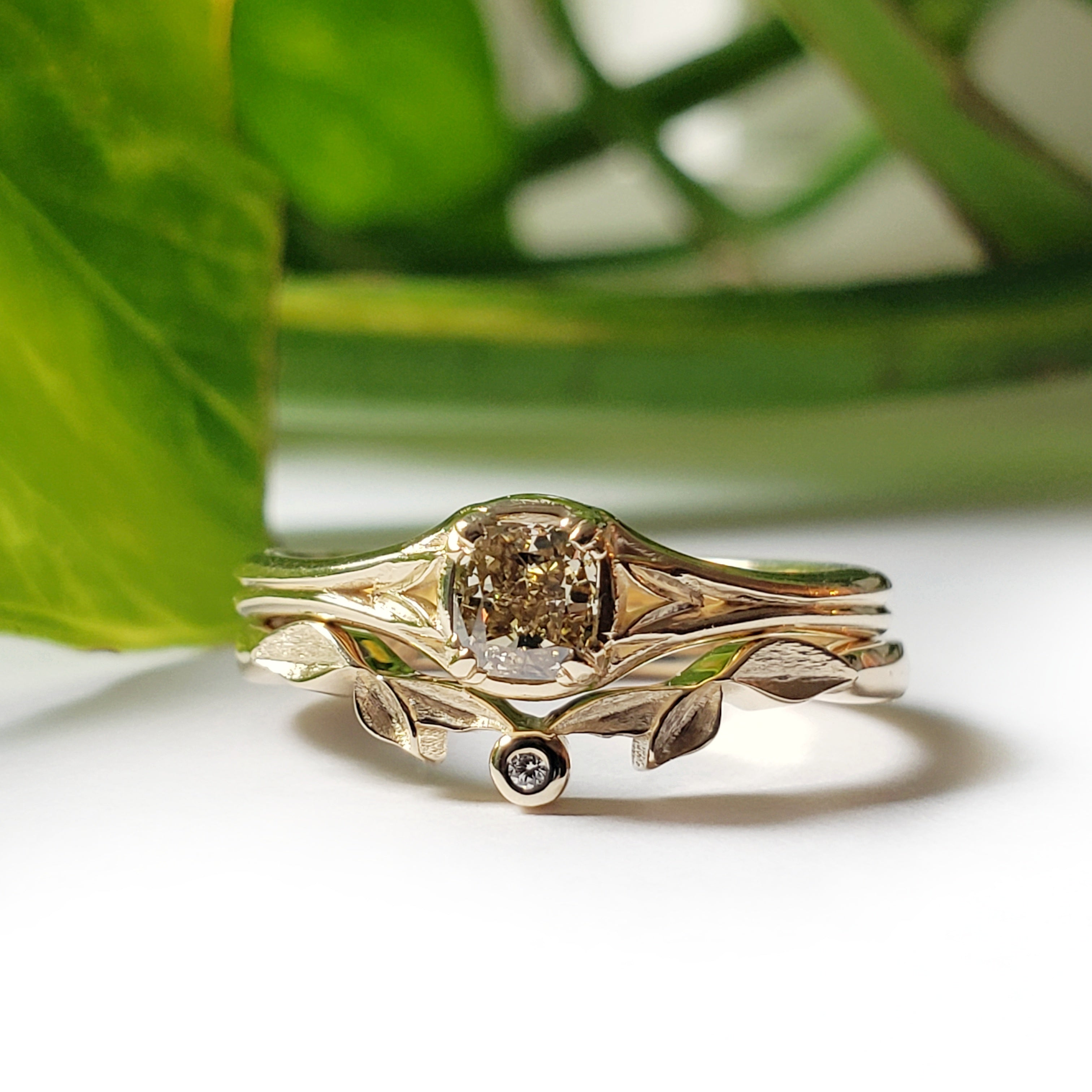 14kt yellow gold Idril engagement ring cushion cut cognac brown diamond solitaire leafy era design