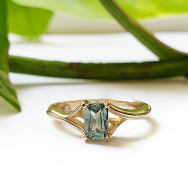 14kt yellow gold twig engagement ring emerald cut green Australian sapphire leafy band era design