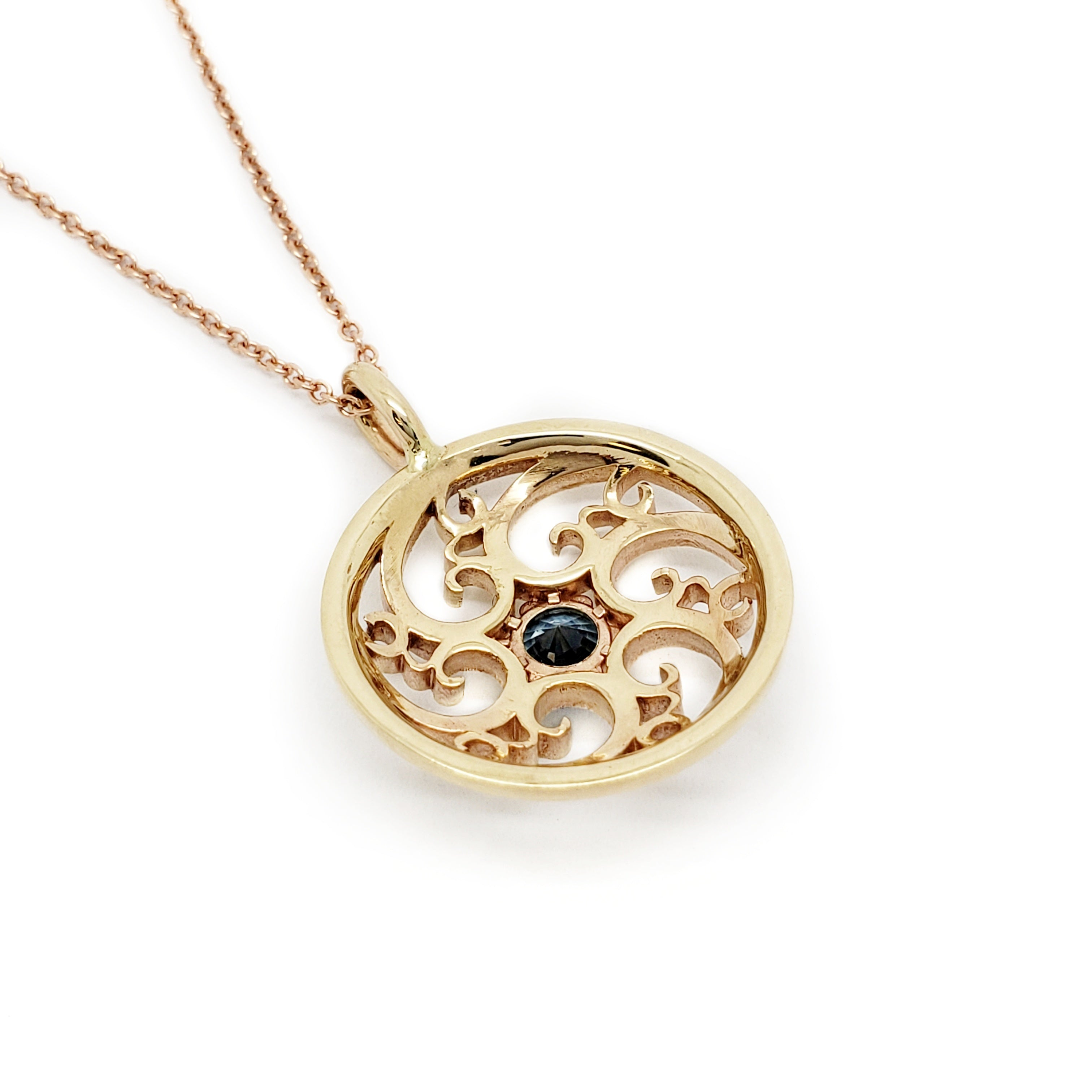 handcrafted unique 14kt yellow gold circle circular swirl pendant filigree blue montana sapphire necklace era design