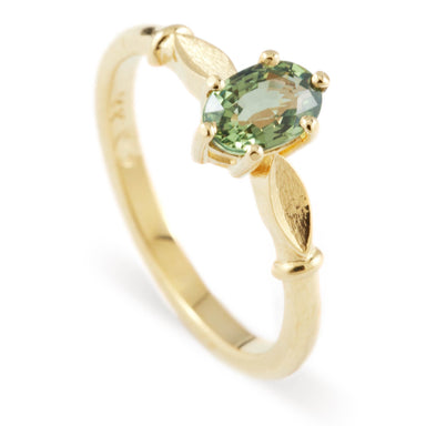 14kt yellow gold eva engagement ring oval green sapphire 6 claw leaf solitaire era design vancouver