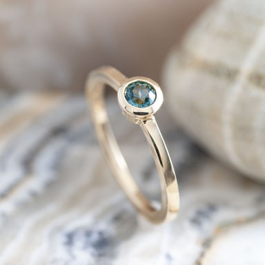 14kt yellow gold Nue solitaire engagement ring blue teal Montana sapphire era design vancouver
