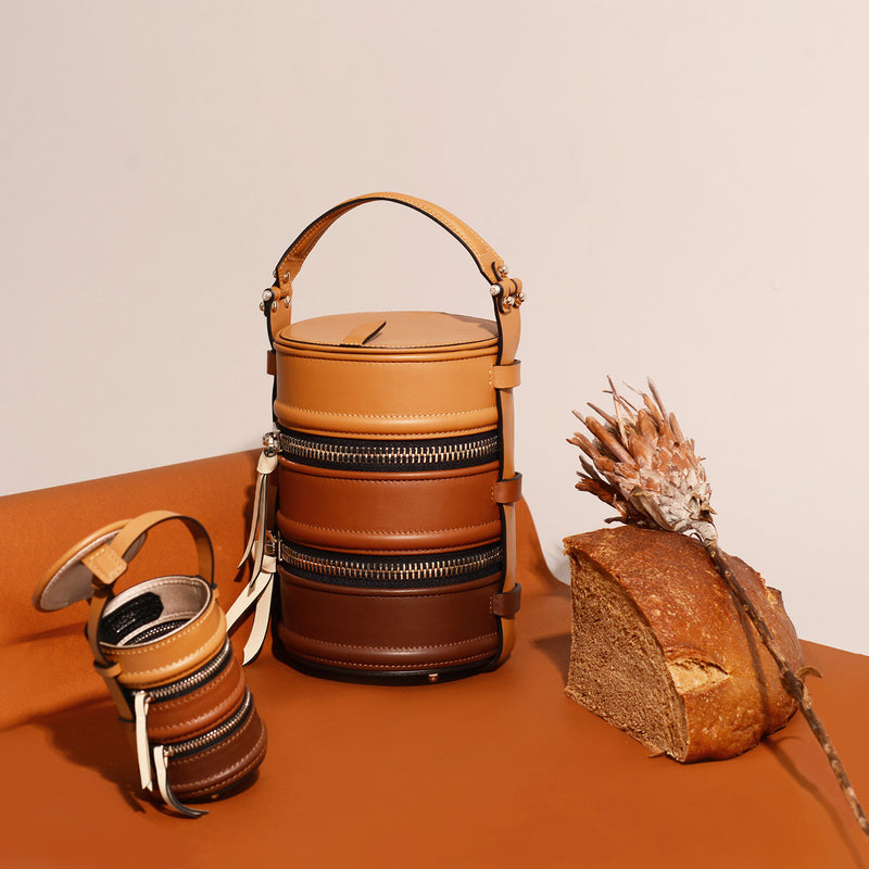 #NashaPinto Leather Bag Charm & Mini Bucket Bag in Pinto Lunch box shape with 1 leather handle and 1 leather strap. Pinto Series has 3 sizes, Original, Mini, Baby size.  NASHA MADE IN MARS / NASHABAG / #NASHAPINTO กระเป๋า ปิ่นโต