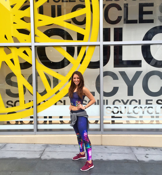 SoulCycle instructor Lisa Boccuzzi wears Terez NYC Nights Leggings and Crop Top