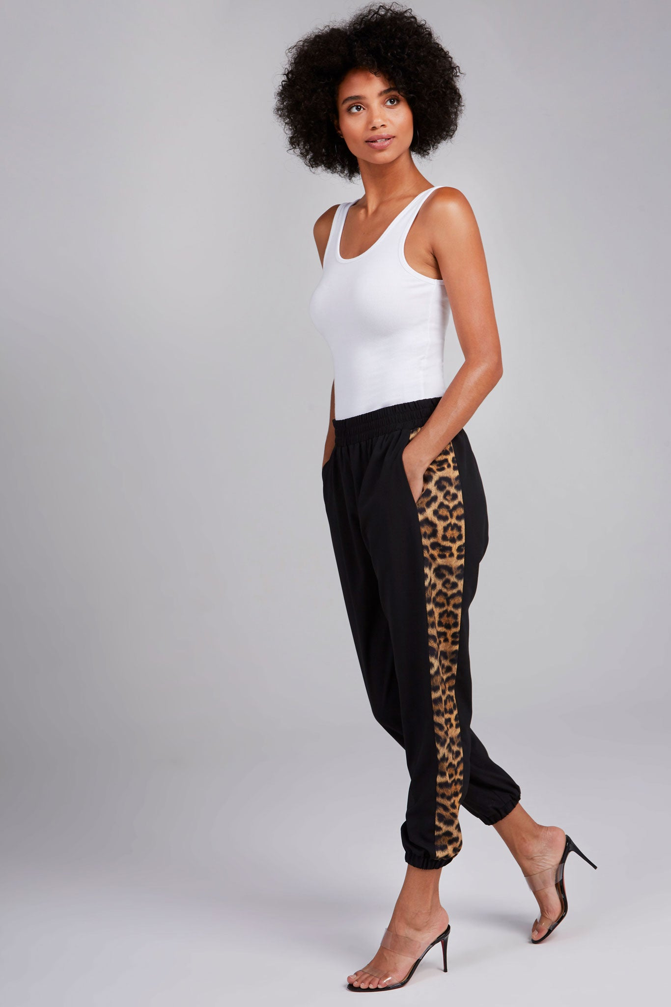 Black track pants with leopard fur print