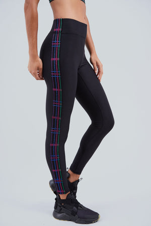High rise, full length, black legging with panels of plaid on the side of the legs