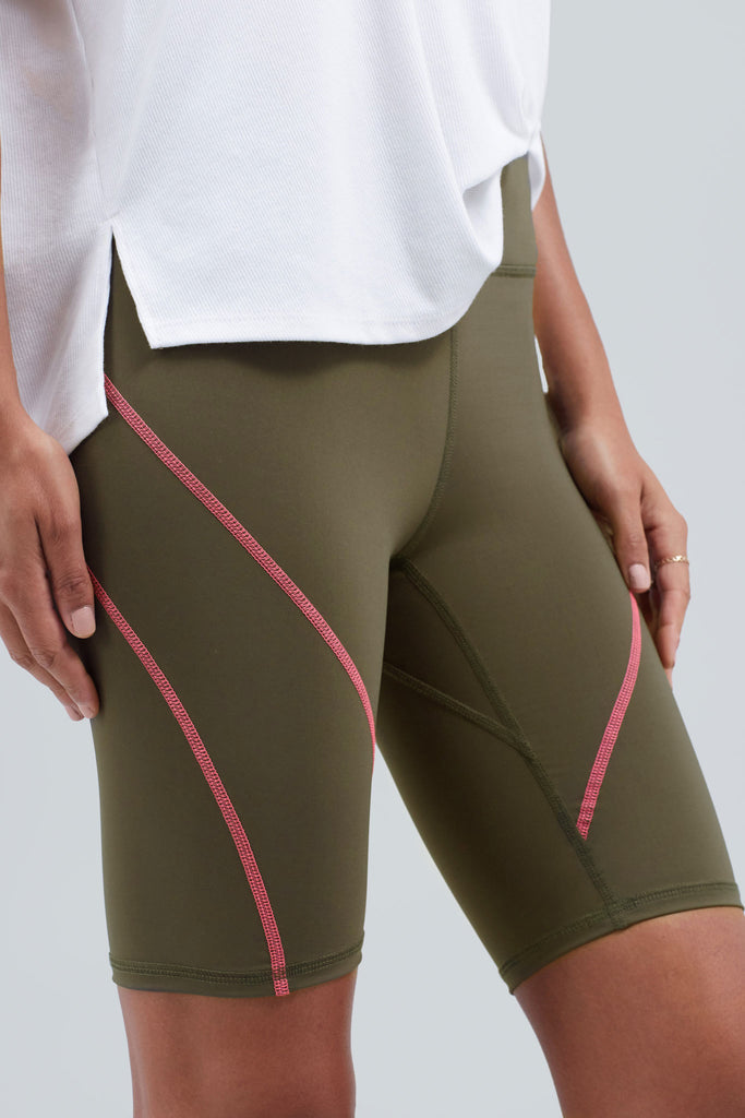 Olive biker short with neon pink stitching