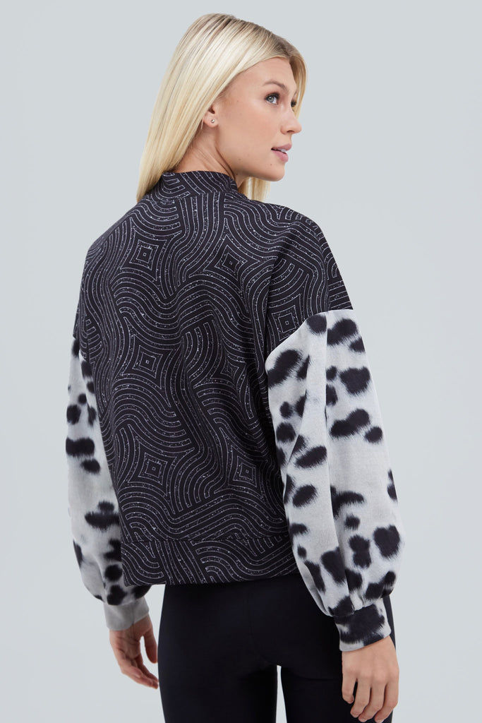 Black mockneck with glitter maze pattern and dalmation fur print balloon sleeves