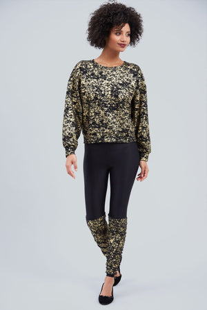 Black legging with built in gold foil dusting legwarmers