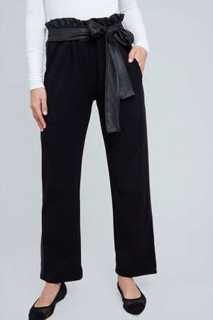 Black, bell bottom pant, with shiny black belt and side panels