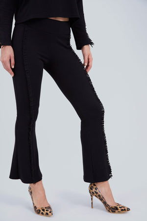 Black, boot cut pants, with black fringe on the side of the legs