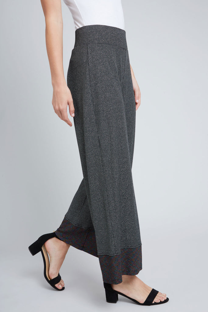 Sliver shimmer, wide leg pant, with black rainbow shimmer trim on the bottom of the leg