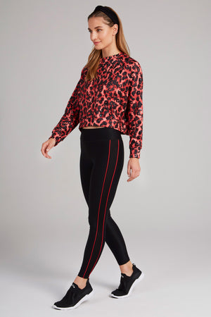 Black, full length, high waisted leggings with red piping down the side of each leg