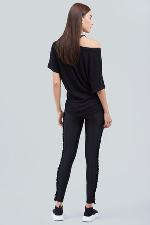 Black, full length leggings, with black fringe on the side of the legs