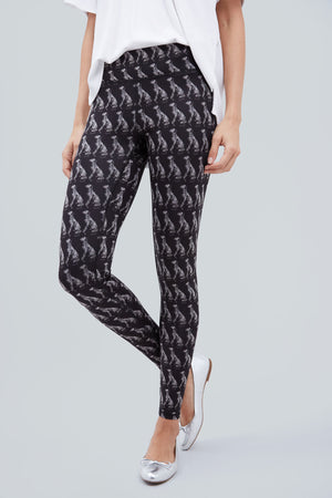 Black, full length leggings with all over pattern of dalmatian dogs